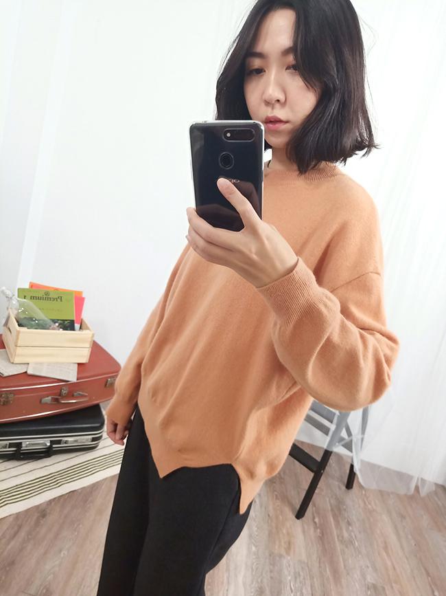 斜下襬粉嫩針織衫